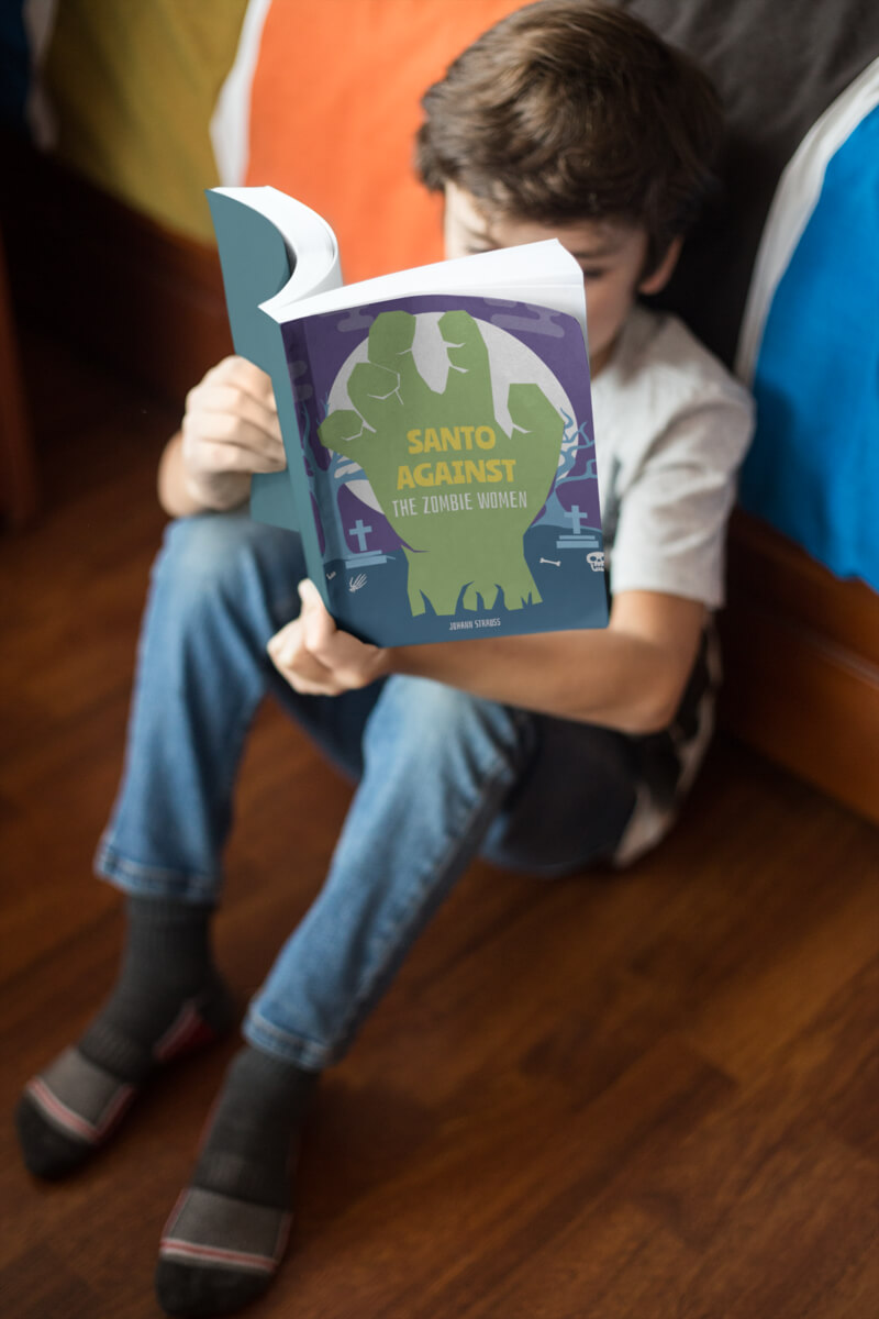 Kid Reading Paperback Book