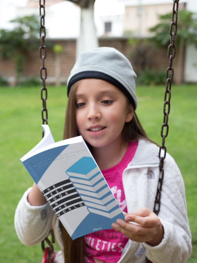 Happy Kid Reading Book on a Swing