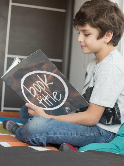 Smiling Kid Reading Paperback Book