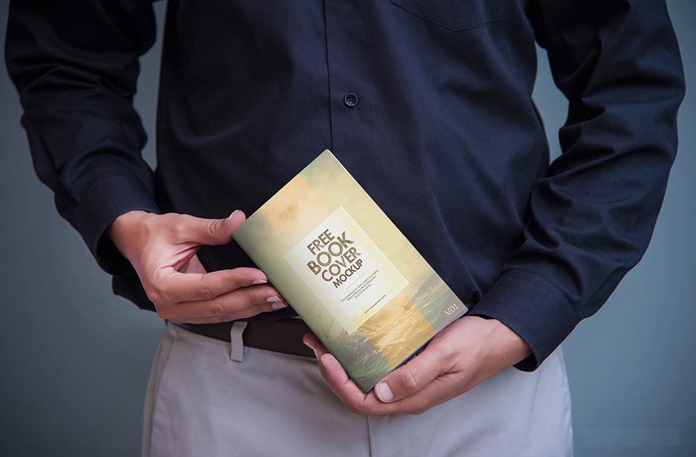 Man in Long Sleeves Holding Book