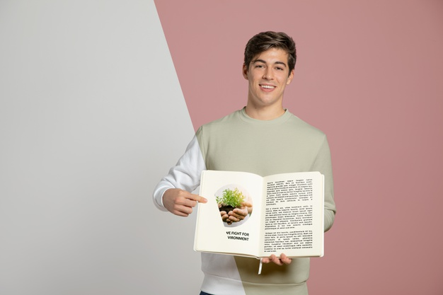 Man Holding and Pointing at His Book