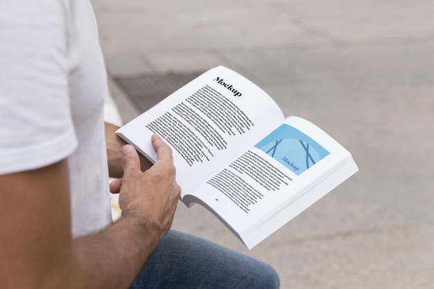 Close up of Man on the Street Reading