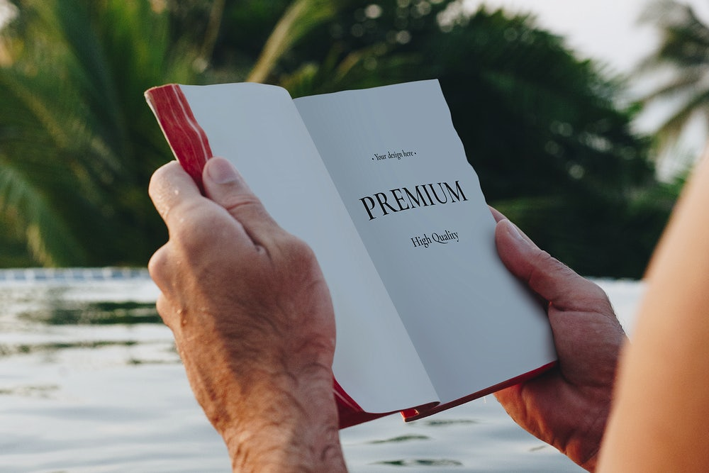 Man Reading Book in the Swimming Pool