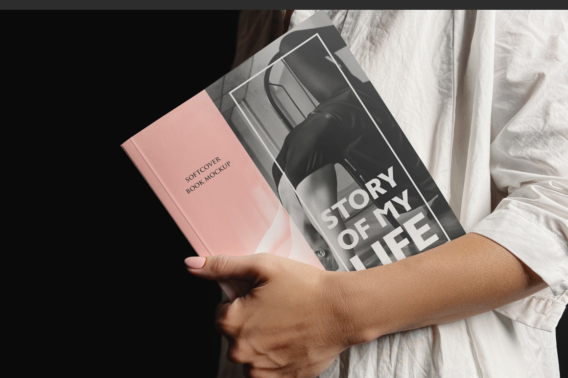 Softcover Book Held By A Woman