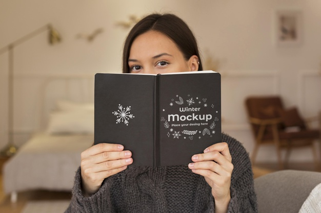Woman Holding Book Covering Her Face