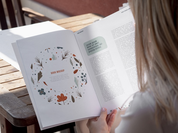 Back View of Woman Reading a Nature Book