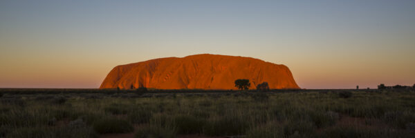 This image of Uluru as sunset was taken from the popular viewing area in the Uluru-Kata Tjuta National Park and UNESCO World Heritage site.