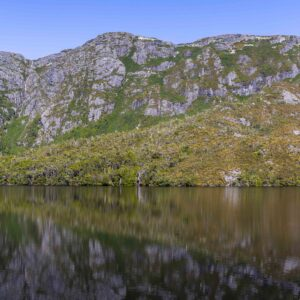 Dove Lake at Cradle Mountain mirror like reflection of Marion lookout and that plateau on the west side of the Lake on the surface