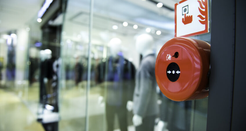 fire alarm on wall of shopping center