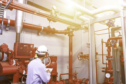 Engineer check red generator pump for water sprinkler piping and