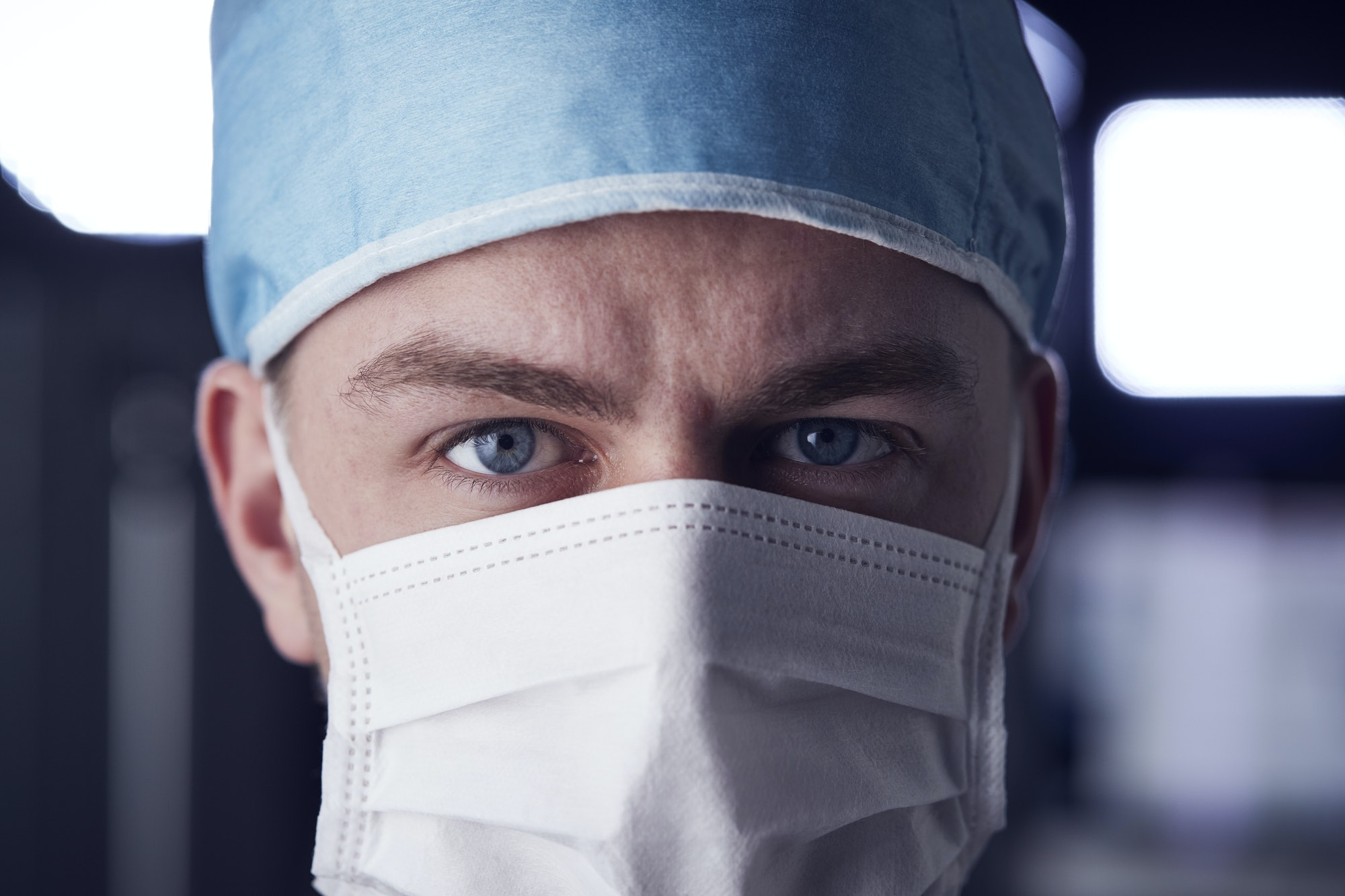 Male healthcare worker in scrubs, head shot