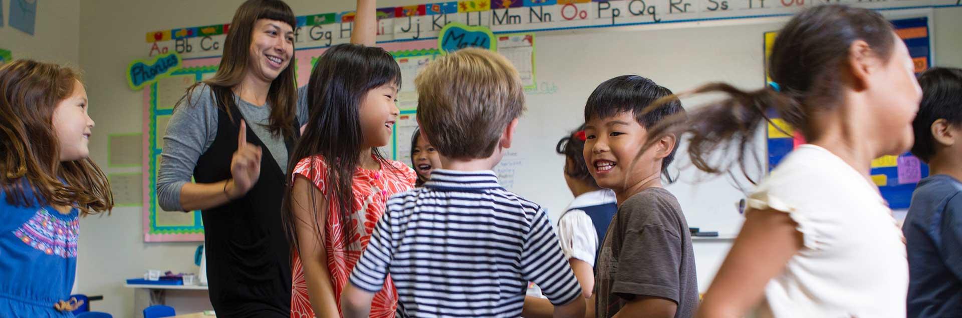 Kids dancing with teacher