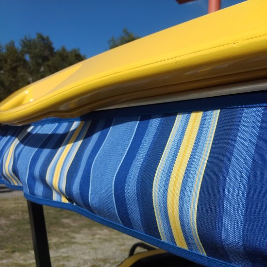 a yellow and blue striped tie