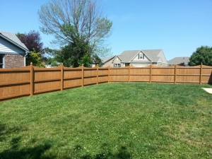 After Guy Painting Fence Staining