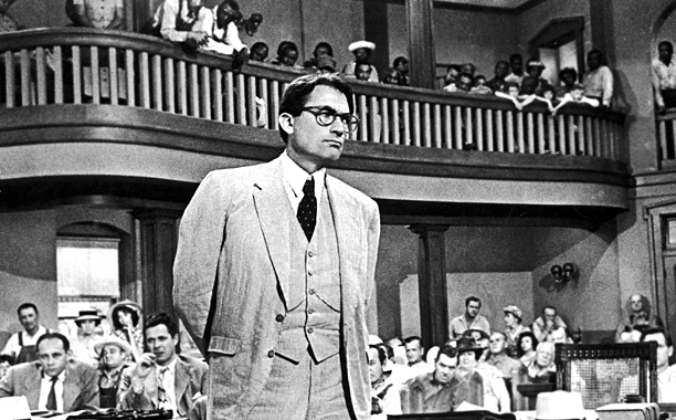 """Picture of Atticus Finch standing in a courtroom from the movie """"To Kill a Mockingbird"""" based on Harper Lee's book of the same title."""
