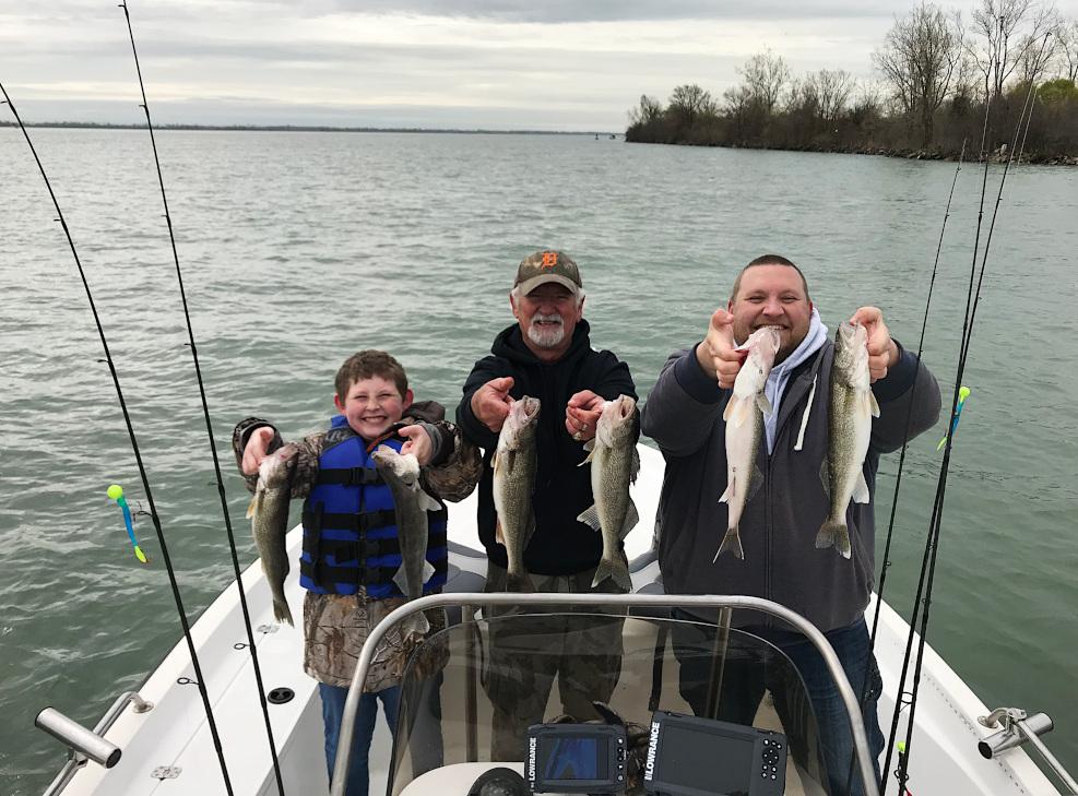 Walleye fishermen holding walleye on the Detroit River