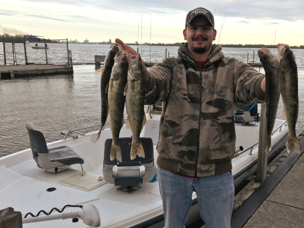 Fisherman with limit of walleye