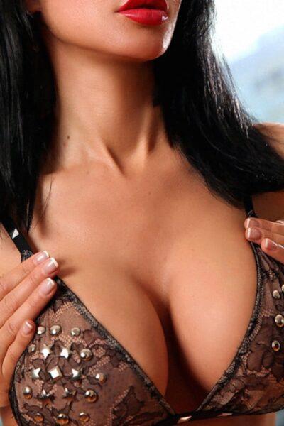 Busty Toronto escort wearing a brown bra