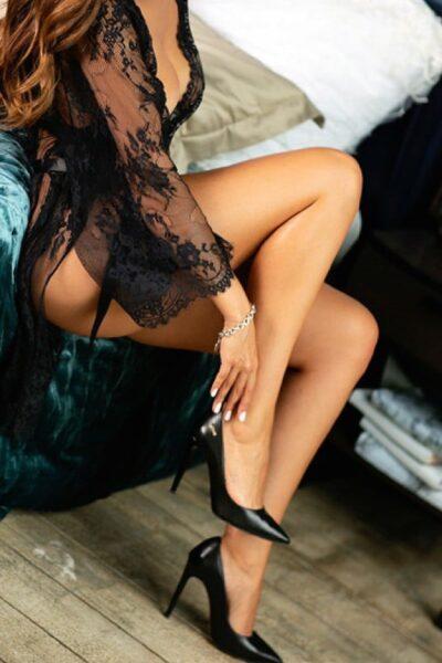 Escort Avery wearing a transparent black night robe