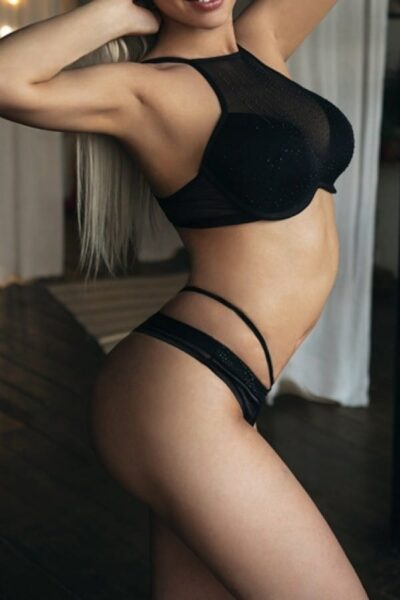 Body of a blonde female escort in lingerie
