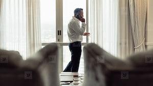 Man calling an escort agency for a date