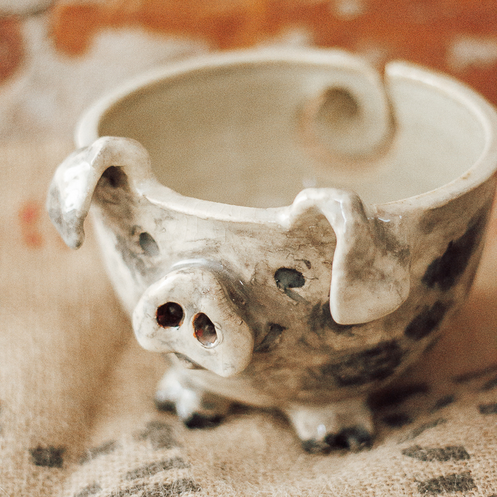 "<p style=""font-size: 16px; line-height: 150%;""><strong>Sculptural Piggy Yarn Bowl&emsp;</strong><br /> 5&frac12;&rdquo; wide x 5&frac12;&rdquo; tall<br> <em>pull yarn through his nose or tail, needles can stick out the nose</em><br> <strong>$100</strong></p>"
