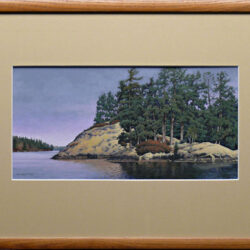 Radiant Rock Ridge is an original 7.5 x 15 inches mixed media landscape painting © 2006 Marv Espe. Beautiful lake scene with a rocky ridge and evergreen trees at the shore. Framed.
