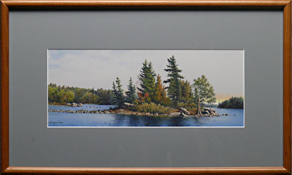 Amidst Open Waters is an original 6.75 x 17 inches mixed media landscape painting © 2005 Marv Espe. A small island surrounded by the blue water of a forest lake. Framed.