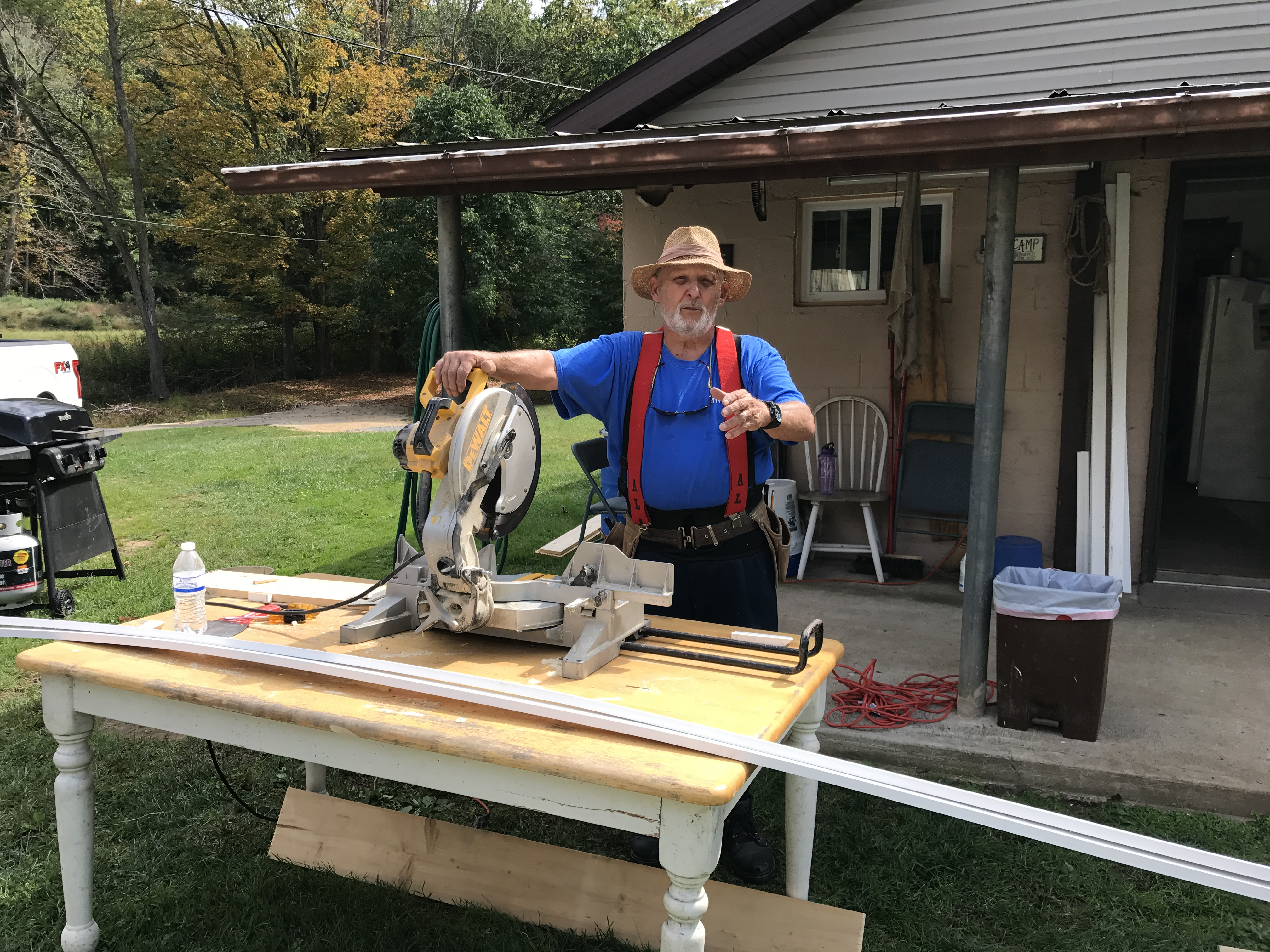 Grant working the circular saw