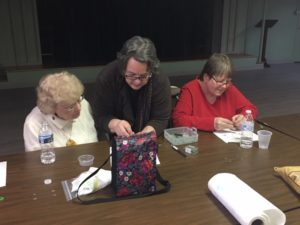 Pastor Judy teaching how to make prayer beads