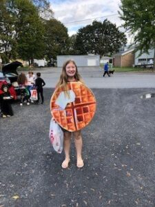 Girl dressed as a waffle at Trunk or Treat