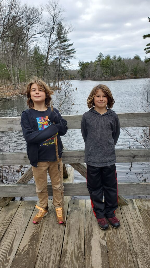 The twins pose in front of the pond at Harold Parker State forest.