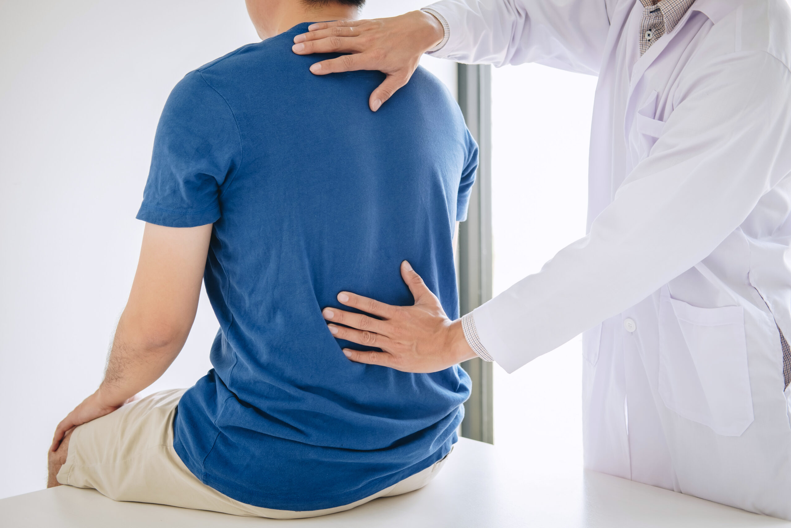 doctor treating back pain
