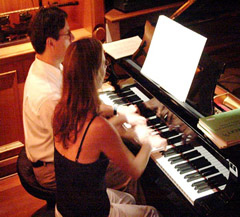 the silvas playing 4 hands together at a piano