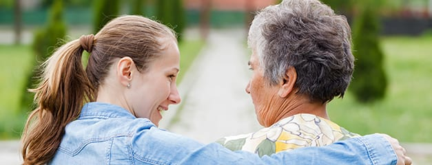 Caring woman with senior