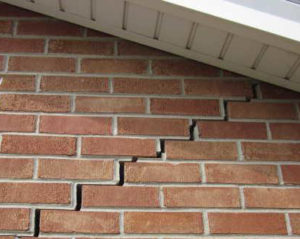 Stair Step Exterior Brick Cracking corrected with deep driven steel pier