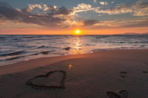 sunset heart in sand