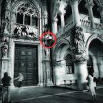 Tourist climbs Porta della Carta