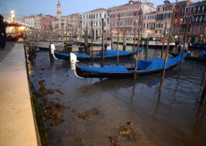 Low Tide in Venice left Gondolas grounded along the Grand Canal