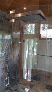 curved glass shower enclosure