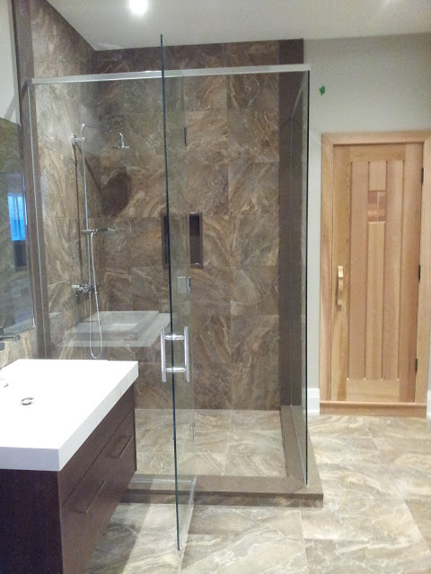 Swinging shower door enclosure