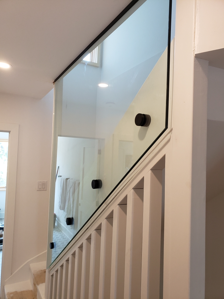 glass railing with black standoffs
