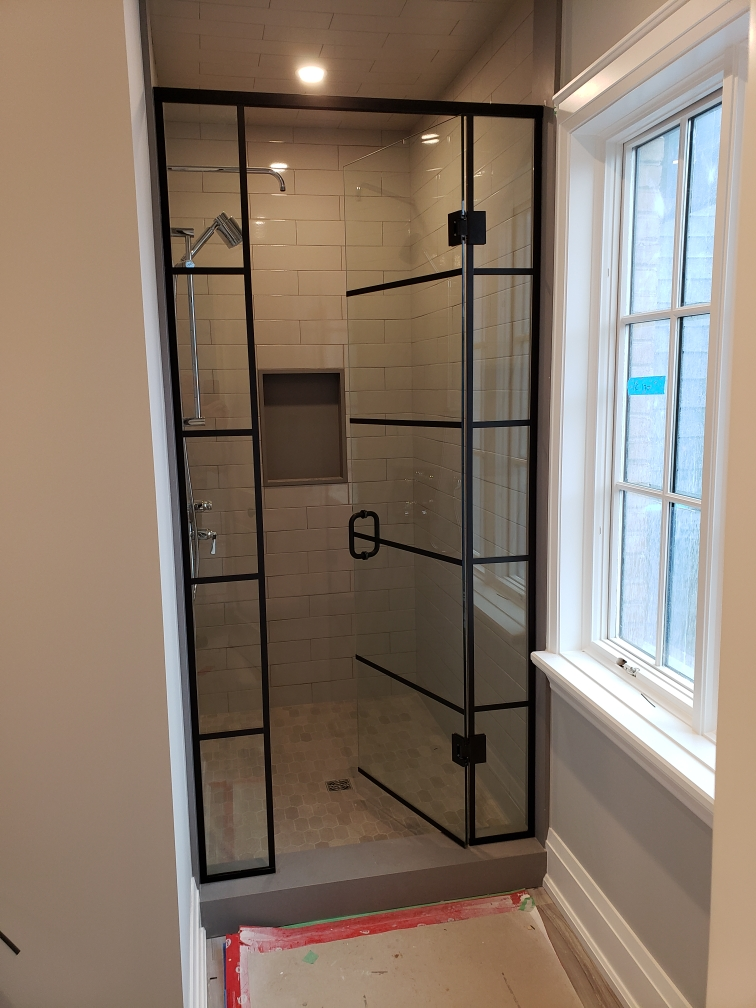 Black mullions on swinging door shower enclosure