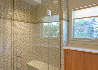 Notched glass shower enclosure to ceiling