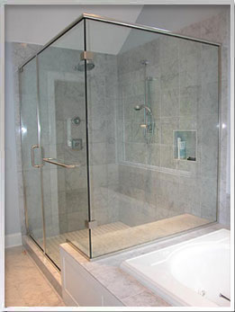 Frameless shower with stainless hardware