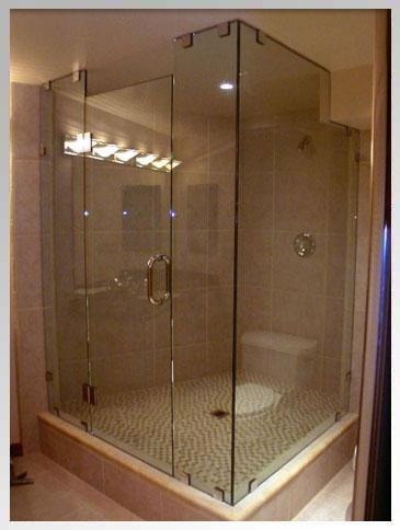 Corner shower with brushed nickel hardware