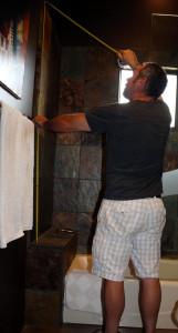 Installer measuring shower