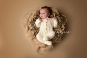 Read more about the article Classic Newborn Footed Romper – Crochet Pattern