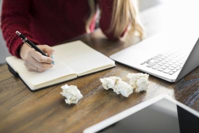 female author writing