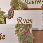 Group of Yule Place Cards Holiday & Hearth Holiday and Hearth Lisa Novelline Lisa Anne Novelline author writer The Dance of Spring craft blog creative blog creativity decorator blog festival celebration seasons nature blog Winter Christmas Yule yuletide Winter Solstice December personalized place cards placards placecards holly cones ivy berries gold names handcrafted